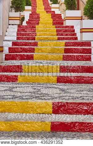 Picturesque Decorated Stone Street With Spanish Flag In Calpe. Spain
