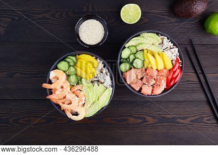 Poke Bowl With Shrimps,salmon, Avocado, Rice, Cucumber, Mango, Pepper And Sesame Seeds, Soy Sauce On