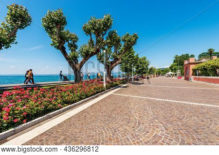 Bardolino, Italy - May 26, 2021: Pedestrian Zone With Some People Walking On The Coast Of Lake Garda