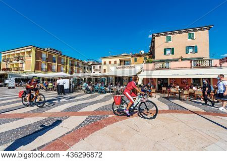 Lazise, Italy - May 26, 2021: Lakefront Of The Small Lazise Village With Restaurants And Pizzerias,