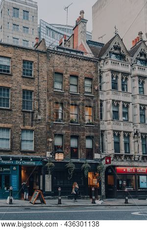London, Uk - October 09, 2021: Woman Walks Past Shops On Fleet Street, A Major Street Mostly In The