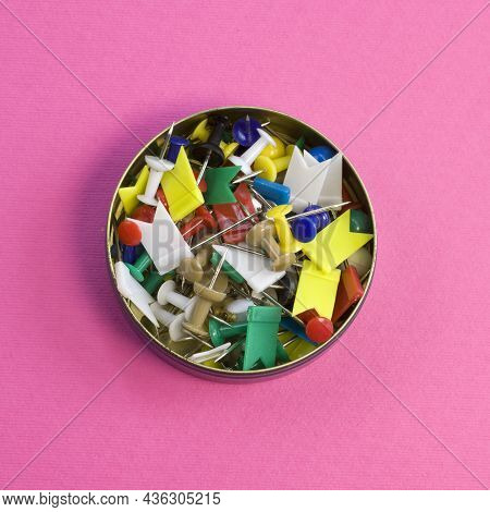Rainbow Colored Straight Pins Collection In Tin Can On Bright Pink Background Top View