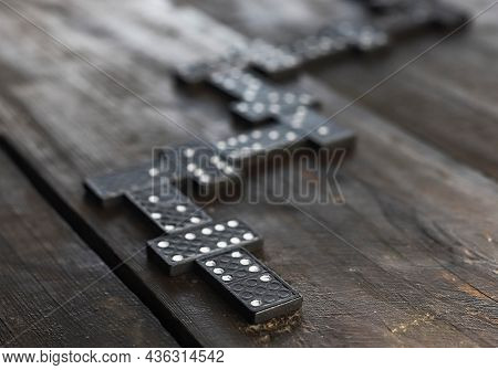 Domino Pieces On Wood Table In Order Of Game. Concept Of Way.
