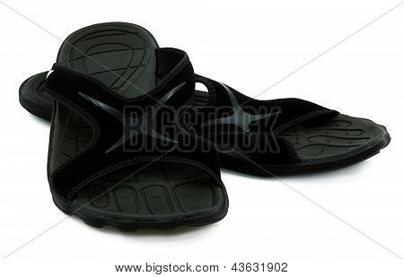 Pair Of Black Sport Sandals Over White