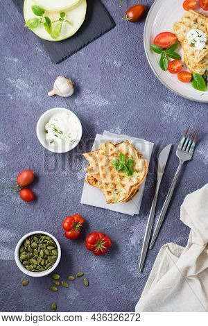 A Stack Of Ready-to-eat Zucchini Waffles And Basil On Baking Paper On The Table. Vegetable Dietary V