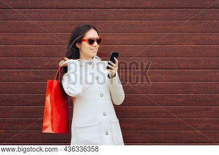 Shopper Holding Smartphone Wearing Heart Shaped Glasses
