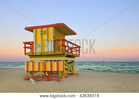 Summer scene in Miami Beach Florida, with a colorful lifeguard house