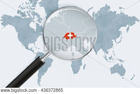 World Map With A Magnifying Glass Pointing At Switzerland. Map Of Switzerland With The Flag In The L