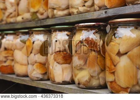 Homemade Canned Mushrooms In Jars. Mushrooms Marinaded In Glass Jars.