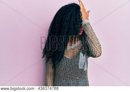 Middle age african american woman wearing casual clothes surprised with hand on head for mistake, remember error. forgot, bad memory concept.
