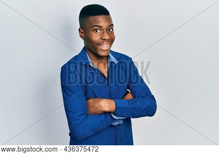 Young african american man with arms crossed gesture celebrating crazy and amazed for success with open eyes screaming excited.