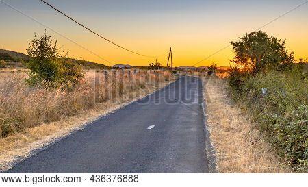 Sunrise Over Road In Highland Limestone Karst Plateau Landscape On Causse De Blandas, Occitanie, Fra