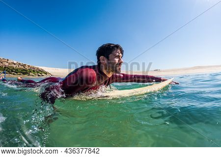 Surfer Rowing Over The Water In Furadouro Beach, Ovar - Portugal