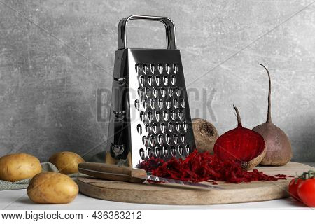 Grater And Fresh Ripe Vegetables On Table