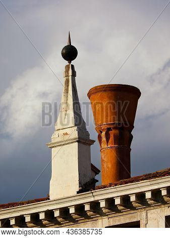 Venice Old And Characteristic Architectures. Stone Pinnacle And Ceramic Chimney