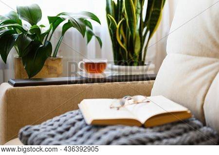 A Cup Of Black Tea In A Cozy Room With Your Favorite Interesting Book. A Cozy Evening For A Literatu