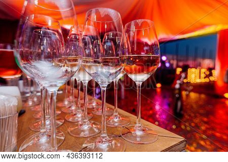Arrangement Of Glasses On The Bar. Alcoholic Beverages In Nightclub. Night Party Celebration In Club