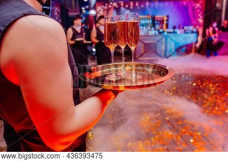 Handsome Waiter Holding In Naked Hands Tray With Glasses Full Of Champagne. Night Party Celebration