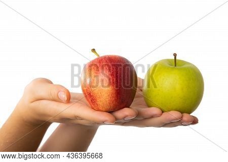 Red And Green Apple Held In Female Hands. Conceptual For Comparison, Differentiation And Choice Sele