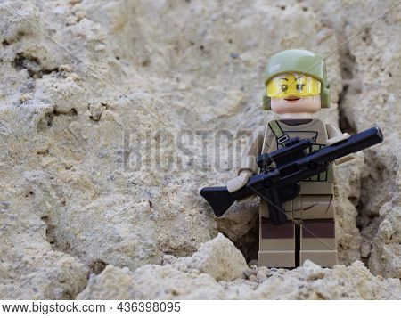Chernihiv, Ukraine, July 13, 2021. Minifigure Of A Girl In A Military Uniform With A Gun, A Close-up