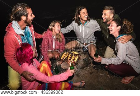 Young Indie Friends Having Fun Together At Night Beach Party Cooking Cobs At Campfire - Friendship T