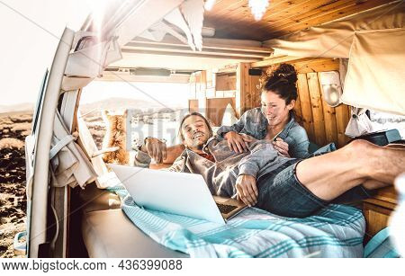 Digital Nomad Couple Traveling Together With Dog On Retro Van Transport - Freedom Life Style Concept