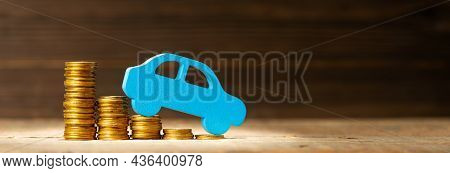 Decrease In Prices For Cars And Components. Reducing The Loan Rate. Stack Of Coins With Steps Down A