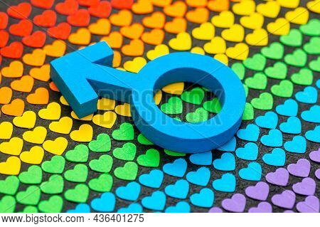 Male Gender Symbol On A Background Of Hearts In The Colors Of The Rainbow As A Symbol Of The Lgbt Fl