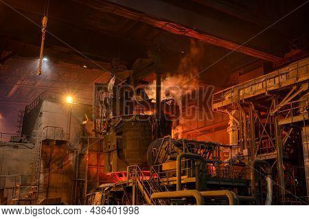 Loading Scrap Metal Into An Electric Arc Furnace