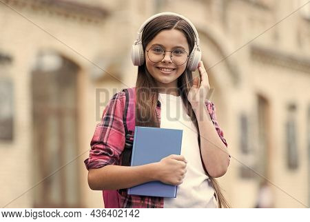 Practise Your Listening Skills. Happy Kid Listen To Audio Book In Headphones. English Listening Less
