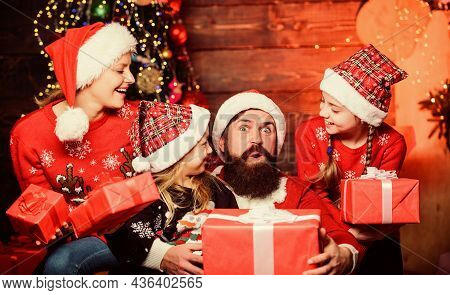 All Wrapped Up In Happy. Father And Daughters On Christmas. Father And Children With Christmas Gifts