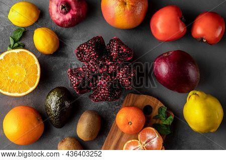 Flat Lay Composition With Fresh Multicolored Fruits. Orange, Kiwi, Grapefruit, Pomegranate, Avocado,