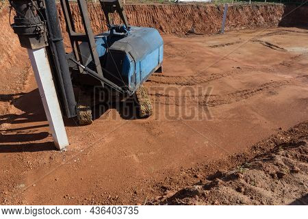 Foundation Piles Drilling Machine. Driving Piles For The Foundation Of A New House. Hydraulic Pile D