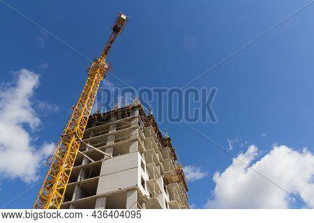 Concrete Building Under Construction. Monolithic Construction. Modern Construction Of Concrete Build