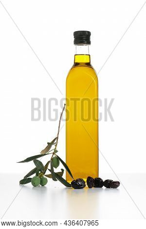 Extra Virgin Olive Oil In A Glass Bottle Isolated On White Background.