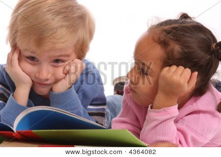 A Boy Young And A Young Girl Reading