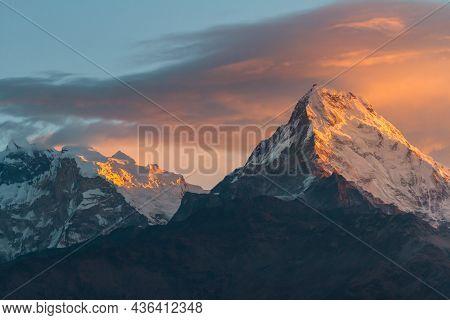 First Sunbeams Lighting The Peak Of Mount Annapurna South On Sunrise, Annapurna Base Camp , Annapurn