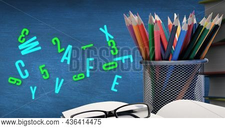 Image of cup with colorful crayons and green letters. education and learning concept digitally generated image.