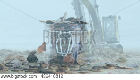 Digital composite image of bulldozer working on landfill against coins falling in a glass jar. finance and economy concept