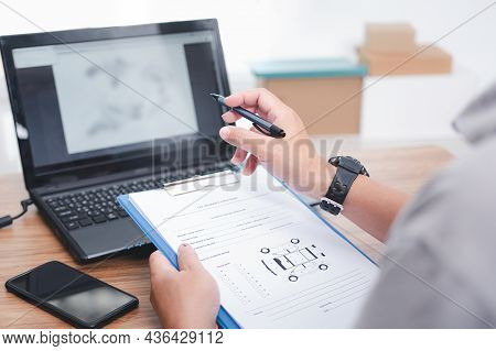 Service Staff Use Laptop Check Spare Parts In Stock Online In Service System For Maintenance Work In