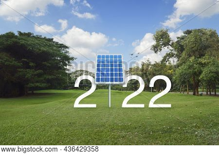 2022 White Text With Solar Cell On Green Grass Field And Trees In Public Park, Happy New Year 2022 E