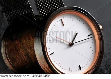 Elegant Wooden Womens Wrist Watch With A White Dial On A Textured Dark Background With Reflection. S