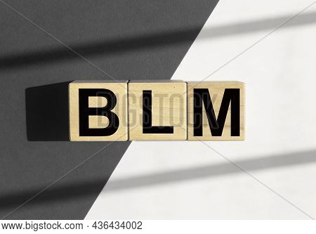 Blm Acronym For Black Lives Matters Movement. Abstract Concept With Gray-black And White Parts.