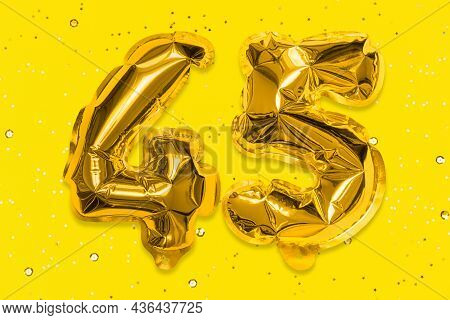 The Number Of The Balloon Made Of Golden Foil, The Number Forty-five On A Yellow Background With Seq