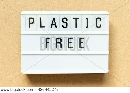 Lightbox With Word Plastic Free On Wood Background