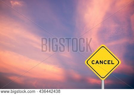 Yellow Transportation Sign With Word Cancel On Violet Sky Background