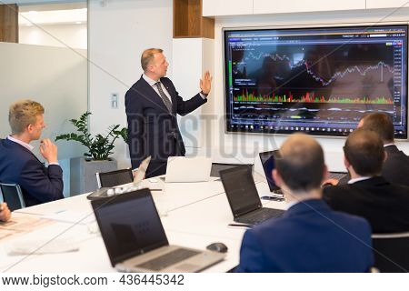 Businessman Making A Presentation On Corporate Meeting.