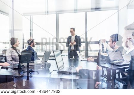 Corporate Business Team Office Meeting In Modern Office.