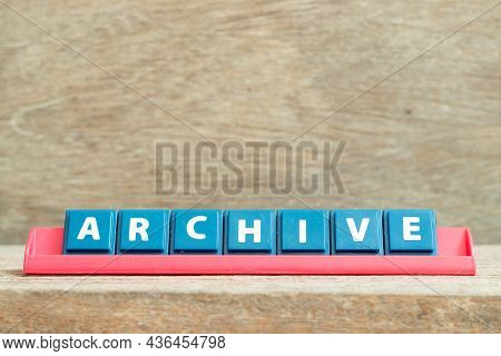 Tile Alphabet Letter With Word Archive In Red Color Rack On Wood Background
