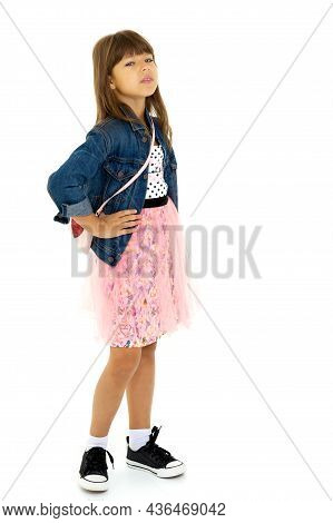 Pretty Girl In Stylish Outfit With Hand On Waist. Full Length Shot Of Cheerful Preteen Girl Wearing